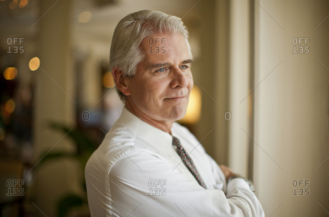 Mature businessman looking away thoughtfully
