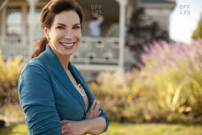 Portrait of smiling mature woman in her backyard