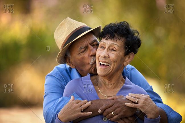 Senior man hugging and kissing his wife