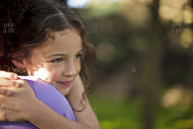Content young girl being hugged