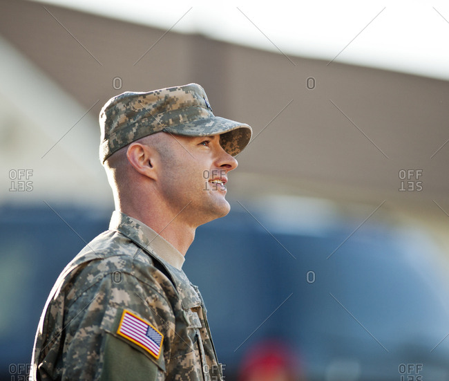 Smiling male army soldier in uniform