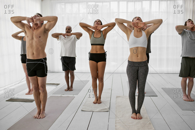 People stretching during a yoga class