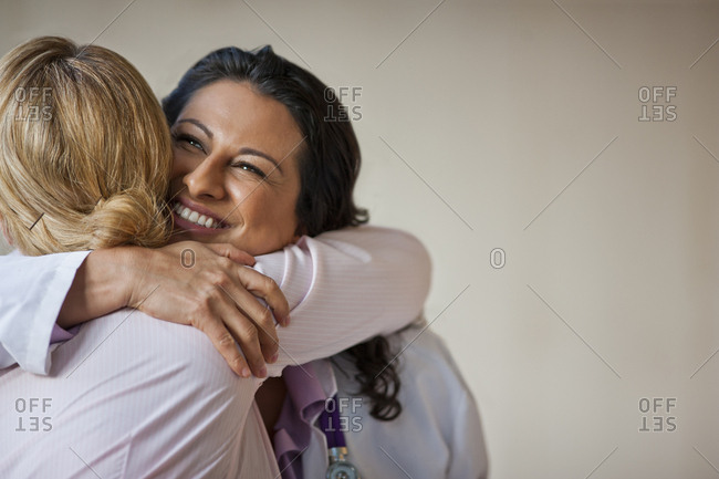 Doctor hugging patient who has received good news