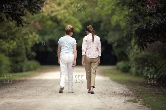 View of a grandmother and a granddaughter taking a stroll
