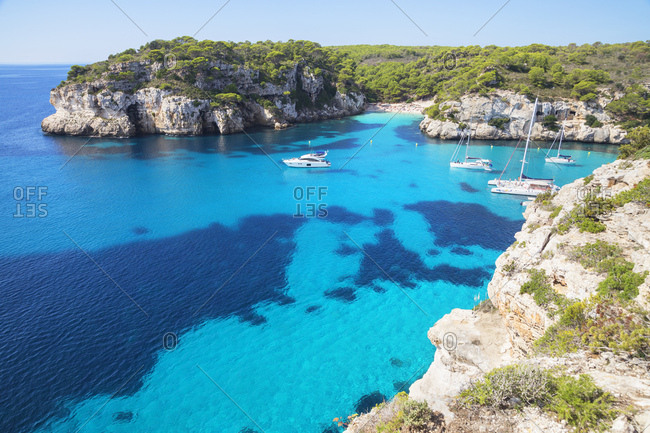 Menorca, Balearic Islands, Spain, Mediterranean, Europe - September 29, 2017: View of Cala Macarelleta and sailboats, Menorca, Balearic Islands, Spain, Mediterranean, Europe