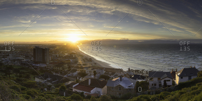 Cape Town, Western Cape, South Africa, Africa - August 4, 2017: View of Muizenberg Beach at sunrise, Cape Town, Western Cape, South Africa, Africa