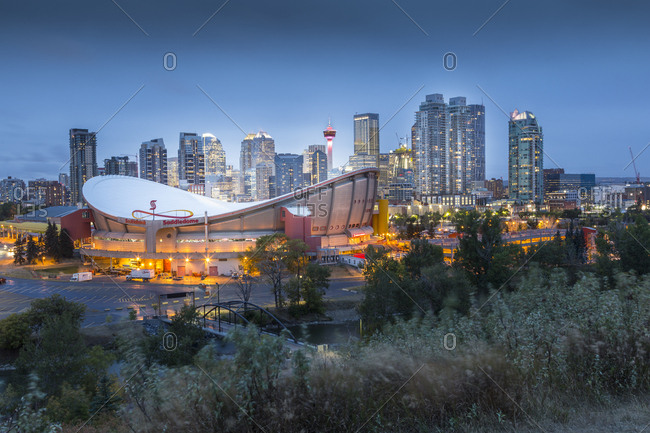 Calgary, Alberta, Canada, North America - September 13, 2017: View of the Saddledome and Downtown skyline from Scottsman Hill at dusk