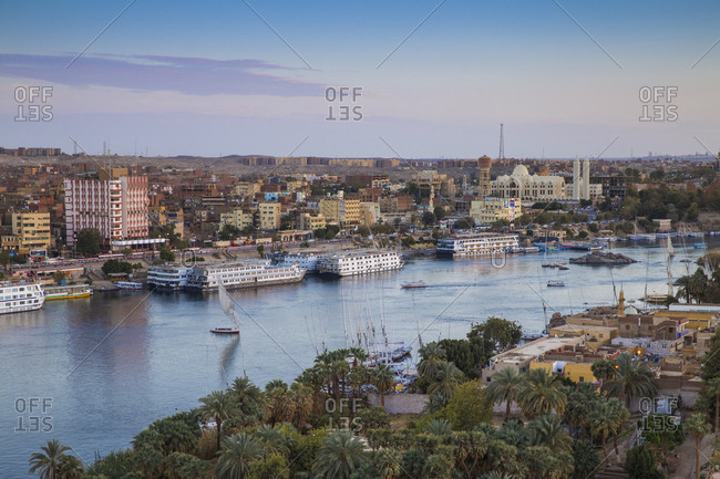 Aswan, Upper Egypt, Egypt, North Africa, Africa - March 12, 2017: View of Aswan looking over Elephantine Island towards The Cataract Hotel