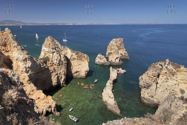 Algarve, Portugal, Europe - June 7, 2017: Excursion boats at Ponta da Piedade Cape, near Lagos, Algarve, Portugal, Europe