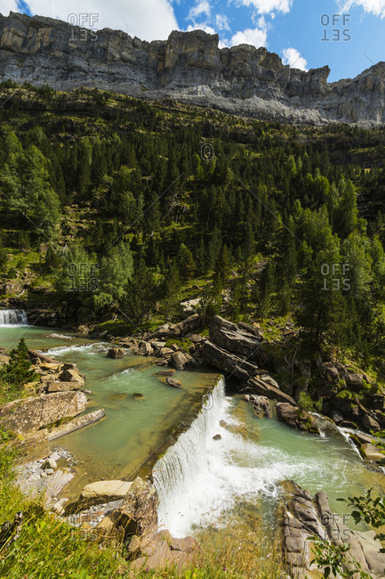 Sierra de las Cutas on the south rim above a Rio Arazas waterfall, Ordesa Valley, Ordesa National Park, Pyrenees, Aragon, Spain, Europe
