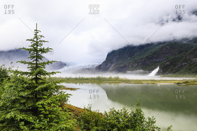 Forest mist and reflections, Mendenhall Glacier and Lake and Nugget Falls Cascade, Tongass National Forest, Juneau, Alaska, United States of America, North America