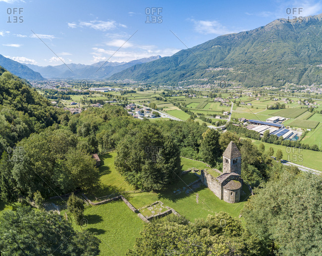Panoramic of medieval Abbey of San Pietro in Vallate from drone, Piagno, Sondrio province, Lower Valtellina, Lombardy, Italy, Europe