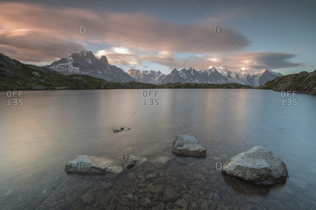 Pink clouds at sunrise on Mont Blanc massif seen from Lacs De Cheserys, Chamonix, Haute Savoie, French Alps, France, Europe