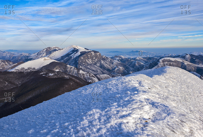 Sunrise on Mountain Catria from the summit of Cucco in winter, Apennines, Umbria, Italy, Europe