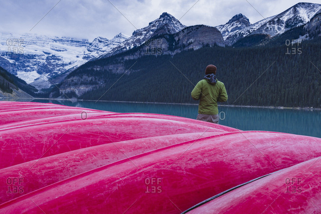 Traveler at the canoe house of Lake Louise, Banff National Park, UNESCO World Heritage Site, Canadian Rockies, Alberta, Canada, North America