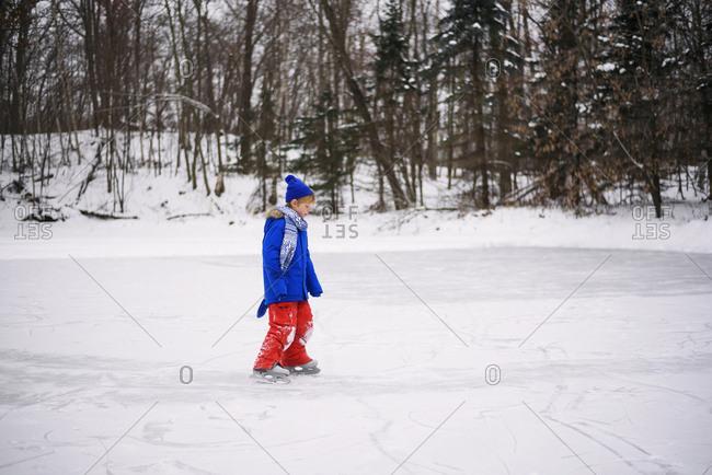 Young boy ice skating