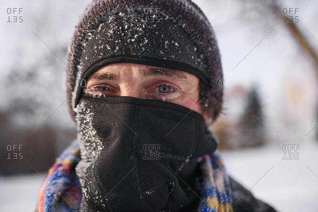 Middle aged man bundled up in the cold