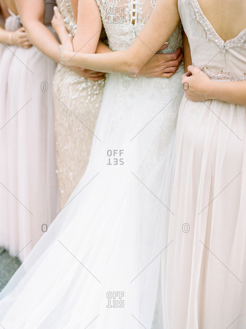 Bridal party gathered close together