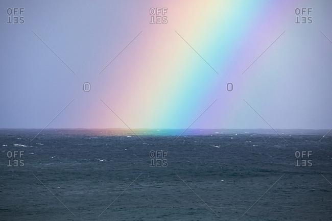 Colorful rainbow over an ocean