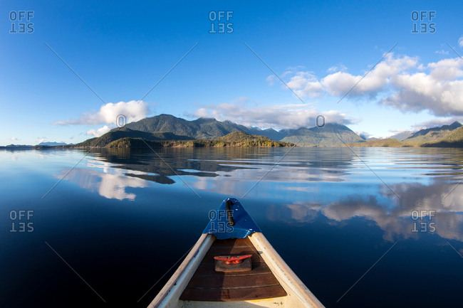 View of beautiful mountain landscape from boat on a lake