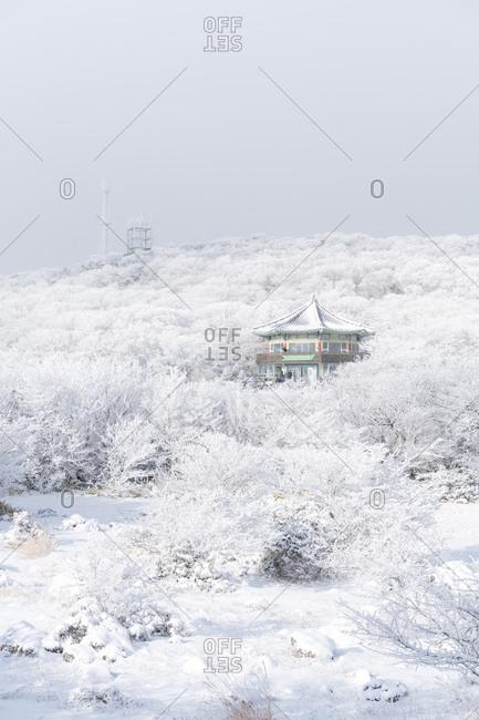 Jeju, South Korea - January 6, 2018: Snow covered building on the slopes of Hallasan