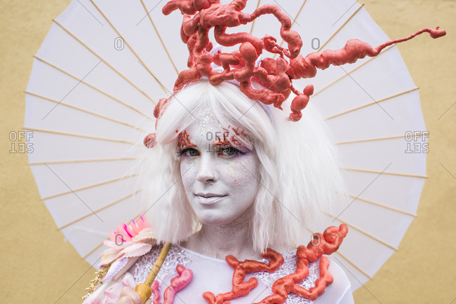 Brooklyn, NY, USA - June 16, 2017: Portrait of young woman wearing coral themed costume at the Mermaid Parade in Coney Island
