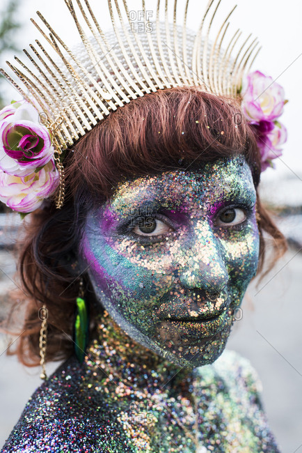 Brooklyn, NY, USA - June 16, 2017: Portrait of young woman painted as sea creature at the Mermaid Parade in Coney Island