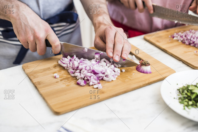 Chopping onions during a cookery class