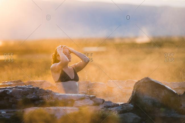 Woman Wearing Bikini Relaxing In Hot Spring