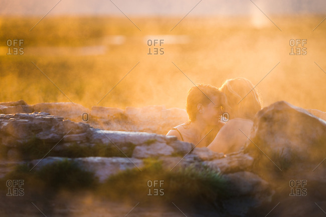 Couple relaxing in hot spring