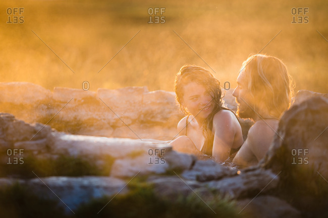 Happy Woman Relaxing With Boyfriend In Hot Spring