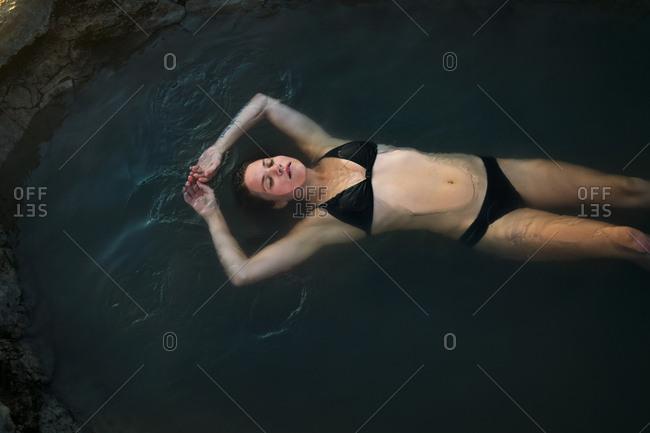 Woman Wearing Bikini Floating in Hot Spring