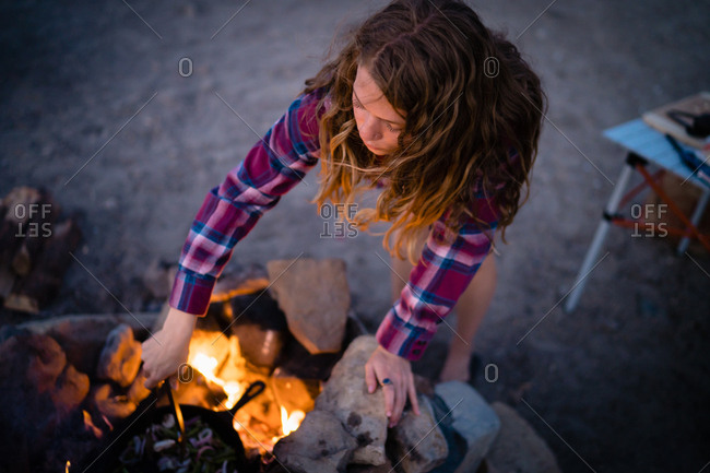 Woman Cooking Food At Campsite