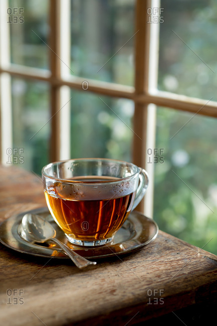 Hot tea by the garden window
