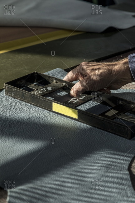Person using molding machine on leather
