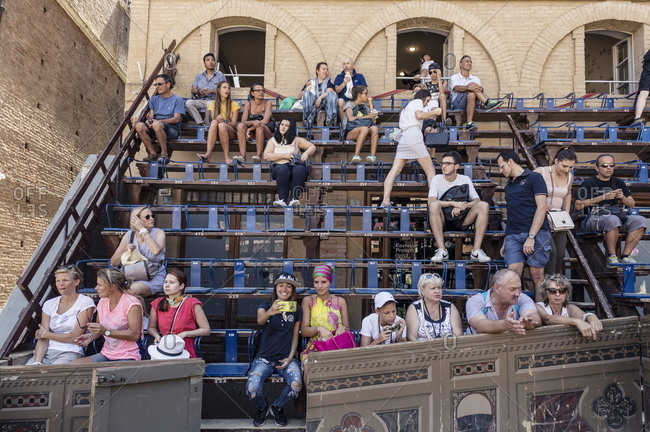 Siena, Italy - August 16, 2017: Spectators at the Palio di Siena horse race