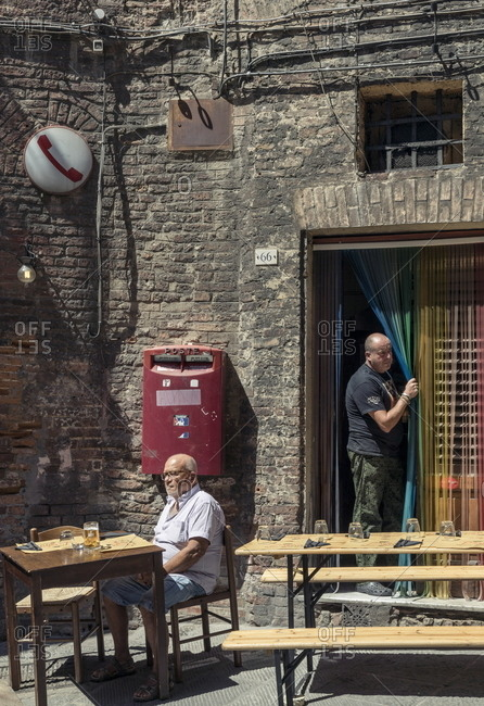 Siena, Italy - August 16, 2017: Daily life in the contrada