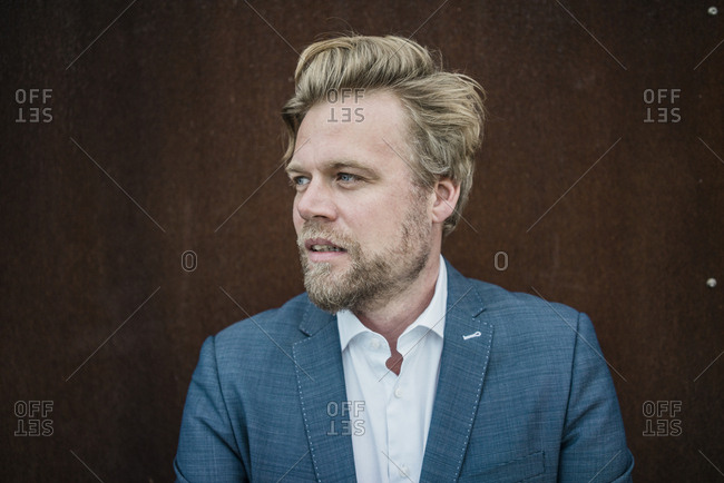 Portrait of businessman outdoors looking sideways