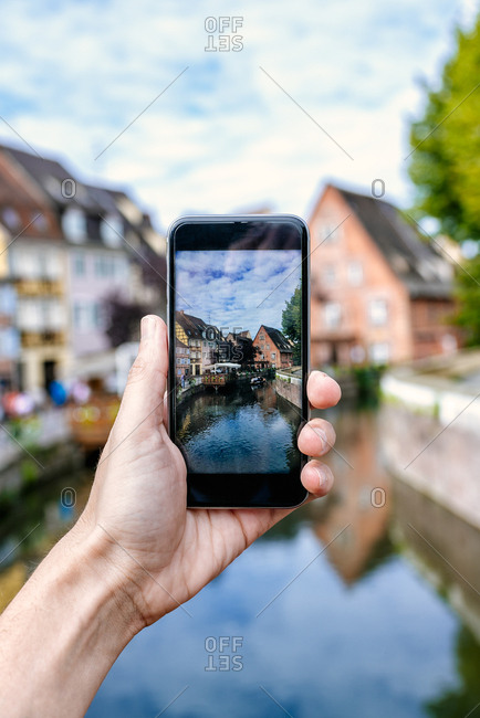 France- Colmar- close-up of a hand of a man taking a picture with his smartphone
