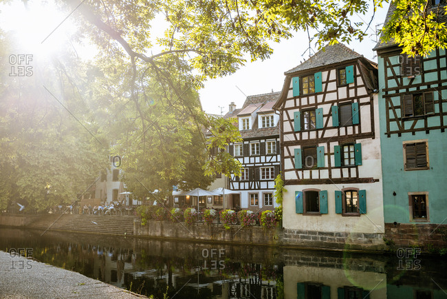 France- Strasbourg- half-timbered houses at river III at sunset