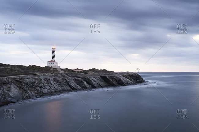 Spain- Balearic Islands- Menorca- Favaritx lighthouse surrounded by clouds in the morning