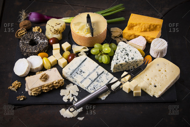 Cheese Platter- cheddar- tete de moine- gorgonzola- goat cheese- french sheep cheese- butter cheese- blue cheese- processed cheese with walnut- pepper cheese- hand cheese- gouda- parmesan