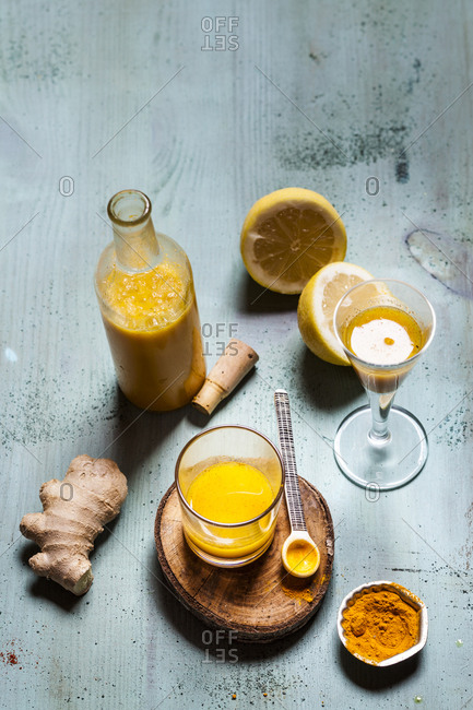 Detox drink- ginger- lemon and orange juice with curcuma and chilli