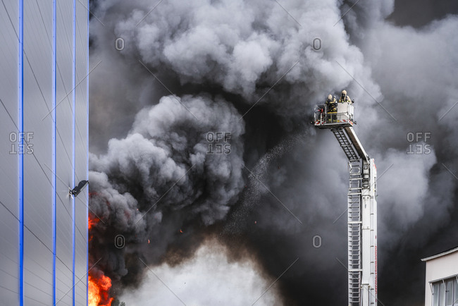 Molndal, Sweden, Scandinavia - August 2, 2017: Firefighters fighting fire