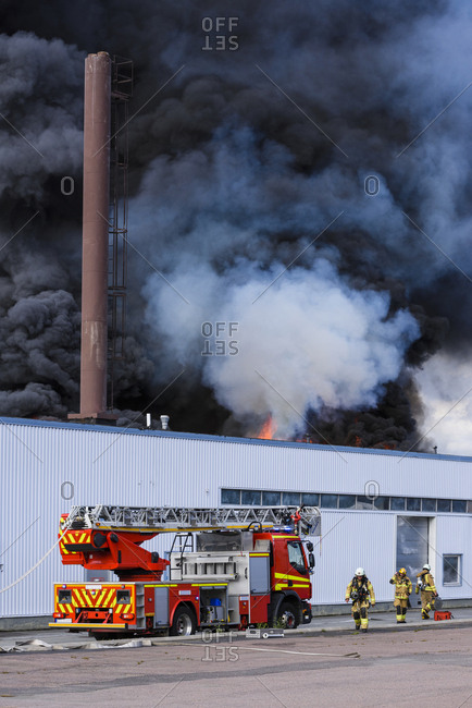 Molndal, Sweden, Scandinavia - August 2, 2017: Fire engine in front of burning building
