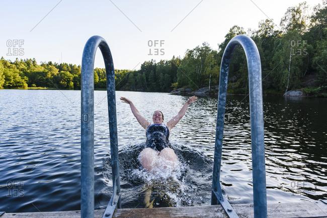 Happy woman swimming in lake