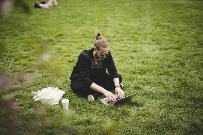 Man using laptop in park