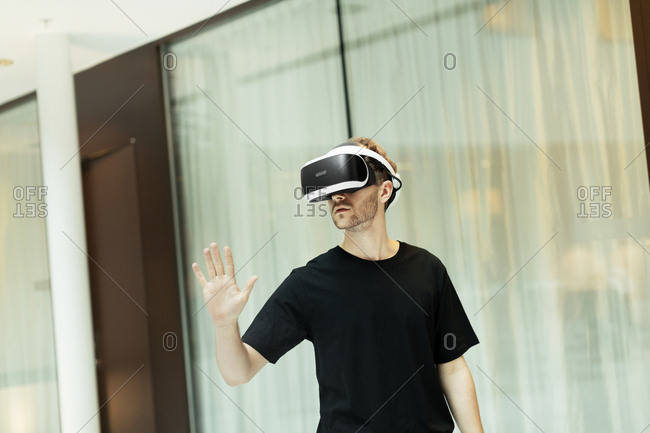 Businessman using VR goggles