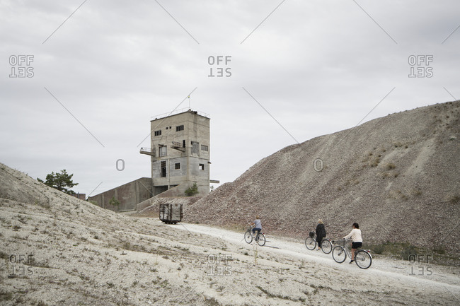 People cycling in old mine