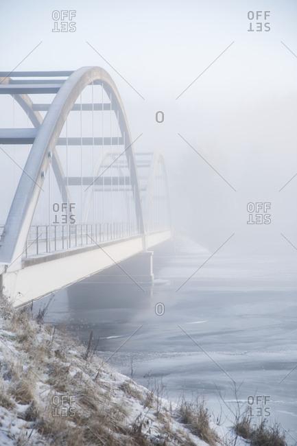 Hump bridge on foggy day